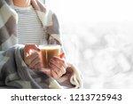 woman's hands holding hot... | Shutterstock . vector #1213725943