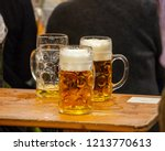mugs of bavarian beer on a... | Shutterstock . vector #1213770613