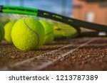 tennis balls on a tennis court | Shutterstock . vector #1213787389