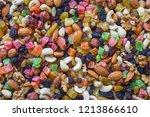 nuts of different varieties are ... | Shutterstock . vector #1213866610