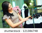 beautiful woman shopping in clothing store - stock photo