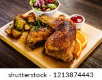 grilled chicken legs with baked ... | Shutterstock . vector #1213874443