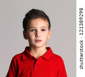 Portrait of adorable young beautiful boy posing at studio - stock photo