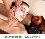 spa massage for young woman... | Shutterstock . vector #121389448