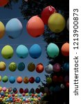 colored balloons hanging on a... | Shutterstock . vector #1213900873