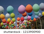 colored balloons hanging on a... | Shutterstock . vector #1213900900