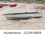wooden fishing boat anchored | Shutterstock . vector #1213914859