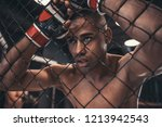 tired afro american fighter in... | Shutterstock . vector #1213942543