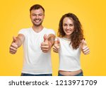 young man and woman in white t...   Shutterstock . vector #1213971709