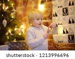happy little boy takes sweet... | Shutterstock . vector #1213996696
