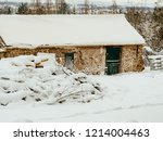 snowy farm  roof and white... | Shutterstock . vector #1214004463