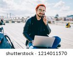 portrait of smiling hipster guy ... | Shutterstock . vector #1214011570