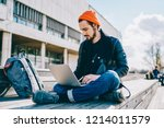 concentrated caucasian student... | Shutterstock . vector #1214011579