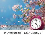 clock and spring cherry flowers ... | Shutterstock . vector #1214020573
