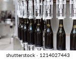glass bottles on the automatic... | Shutterstock . vector #1214027443