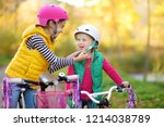 cute little sisters riding... | Shutterstock . vector #1214038789
