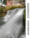 Small photo of Chagrin Falls. The beautiful 20-foot tall waterfall is right in the middle of the small town along Main street. Chagrin Falls is a village in Cuyahoga County, Ohio, United States.