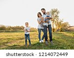 dad mom daughter and son walk... | Shutterstock . vector #1214072449