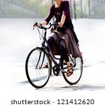 he woman on the bike after work.... | Shutterstock . vector #121412620