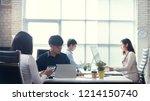 asian people working in office | Shutterstock . vector #1214150740