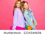 two young stylish smiling blond ... | Shutterstock . vector #1214164636