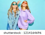 two young beautiful blond... | Shutterstock . vector #1214164696