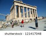 Small photo of ATHENS, GREECE - JUNE 29: Tourists in famous old city Acropolis Parthenon Temple on June 29, 2012 in Athens, Greece. Construction began in 447 BC in the Athenian Empire. It was completed in 438 BC.