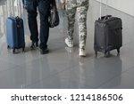 man and a woman walk through...   Shutterstock . vector #1214186506