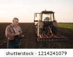 farmer with tablet in field | Shutterstock . vector #1214241079