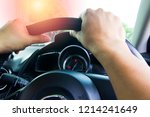 hands of driver in a car | Shutterstock . vector #1214241649