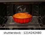 homemade cake in red form baked ... | Shutterstock . vector #1214242480