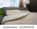 bright and cozy modern bedroom  | Shutterstock . vector #1214242570