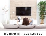 young woman watching tv in the... | Shutterstock . vector #1214253616