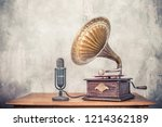 Stock photo vintage antique gramophone phonograph turntable with brass horn and big aged studio microphone on 1214362189