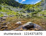mountain lake in the alps with... | Shutterstock . vector #1214371870