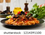 spaghetti with mussels. front... | Shutterstock . vector #1214391100