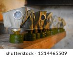 gas masks in a line reminding... | Shutterstock . vector #1214465509
