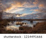 Sunset In Bog With Water...