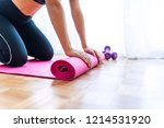 young woman with yoga mat... | Shutterstock . vector #1214531920