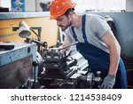 portrait of a young worker in a ... | Shutterstock . vector #1214538409