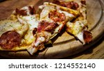 pizza. three pieces of... | Shutterstock . vector #1214552140