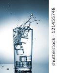Water splash in glass - stock photo
