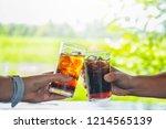 men and woman hand giving glass ... | Shutterstock . vector #1214565139