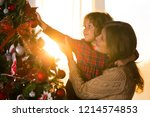 mother and daughter decorate a... | Shutterstock . vector #1214574853