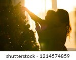 mother and daughter decorate a... | Shutterstock . vector #1214574859