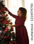 little girl child decorate a... | Shutterstock . vector #1214575750