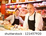 People working in a grocery store - stock photo