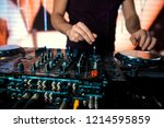 dj mixes the track in the... | Shutterstock . vector #1214595859
