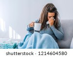 sick woman with headache... | Shutterstock . vector #1214604580
