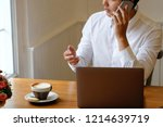 businessman calling a... | Shutterstock . vector #1214639719